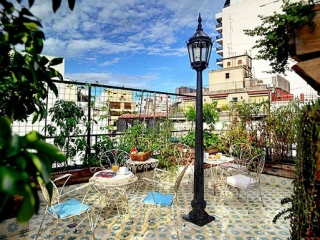 Apart Hotel Buenos Aires Garden Roof Chair Table Lantern Vegetables